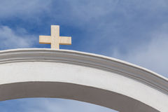 Arch with cross in Oia. White arch with cross in Oia on Santorini Stock Photos