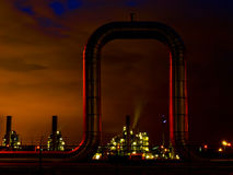 Arch at Dawn. An industrial gas pipe is glowing bright red by illumination of the rising sun royalty free stock photo