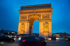 Arch de Triumph, Paris. Evening traffic on Paris road near Triumph Arch. Paris Royalty Free Stock Photo
