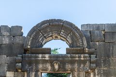The arch is decorated with carvings above the central entrance to the ruins of the Big Sinagogue of the Talmudic Period in Bar`am Royalty Free Stock Images