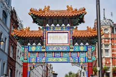Arch Decorated in Chinese art at the Entrance of Chinatown in London, England royalty free stock image