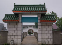 Arch decorated with green Chinese rooftop Royalty Free Stock Image