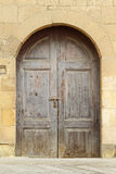 Arch door. Double wooden door with arch castle entrance Stock Images