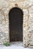 Arch door in Gigondas. Antique arch door in Gigondas, Vaucluse, France royalty free stock photography