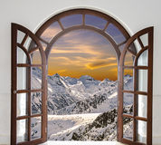 Arch Door Opened With Views Of The Peaks Of Snowy Stock Photo