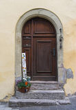 The arch door on the pale yellow wall in Europe Royalty Free Stock Photos