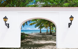 Arch door on the palm alley. Open doorway arch door on the alley of palm trees on a sunny summer day Royalty Free Stock Photo