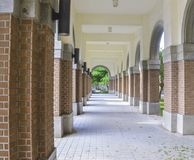 The door of Walkway. The arch door of Walkway in University campus in autumn Stock Photo
