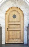 Arch Door. Wooden arch door with marble door way Royalty Free Stock Image