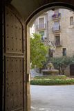 Arch doorway with view of courtyard in Solsona, Cataluna, Spain Stock Photos