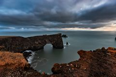 Arch at Dyrholaey in Iceland at sunset stock photos