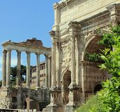 Arch of Emperor Septimius Severus and Temple of Saturn at the Roman Forum in Rome royalty free stock photography