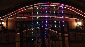 Arch entrance adorned with Christmas lights stock footage