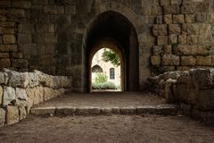 Arch entrance in the backyard of at Emir Bachir Chahabi Palace Beit ed-Dine in mount Lebanon Middle east, Lebanon. Arch entrance of dark bricks in the backyard Royalty Free Stock Photography