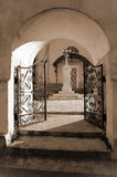 Arch at the entrance to the church. Arch and the wrought-iron gates at the entrance to the church Royalty Free Stock Photo