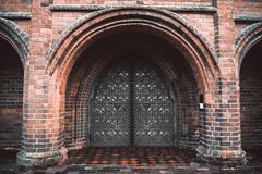 Arch entry door on red brick wall stock photo