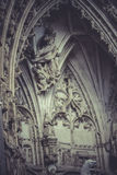 Arch with figures of Gothic style cathedral in Toledo Spain Royalty Free Stock Images