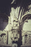 Arch with figures of Gothic style cathedral in Toledo Spain Stock Images