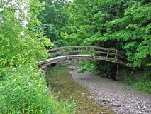 Arch foot bridge Stock Photo