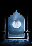 Arch and full moon. Arch silhouette in old temple at night sky with full moon premade background Stock Images