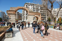 The Arch of Galerius Emperor in Thessaloniki, Greece. Thessaloniki, Greece - MARCH 2, 2015: People walking the Egnatis street at The Arch of Galerius Emperor in royalty free stock photos
