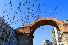 Birds flying over the Arch of Galerius, Thessaloniki Greece. Arch of Galerius or Kamara. Moment of birds flying over the city stock photography