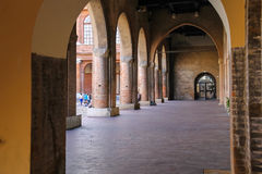 Arch gallery in ancient building on Cavour square in Rimini Royalty Free Stock Photography