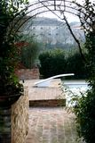 Arch in the garden. Captured in Asciano (SI) - Tuscany in autumn 2006 Stock Photography