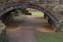 Arch Into The Garden. Sandstone arch into a recreation garden beneath the walls of the Roman City of Chester Royalty Free Stock Photography