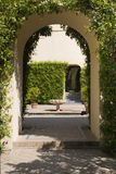 Arch in garden Stock Image