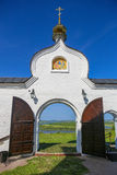 Arch of gate of ancient Christian church. Against landscape Stock Photography
