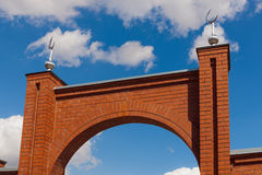 Arch of gate in a mosque. Against the sky Stock Image