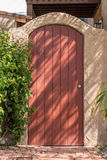 Arch gate. Round top closed plank gate in gate with arch Royalty Free Stock Photos