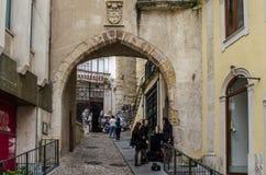 Arch gates in hoistorical center of Coimbra, Portugal. Coimbra, Portugal - July 2014: arch gates in hoistorical center of Coimbra stock images