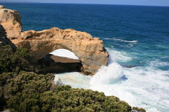 The Arch, Great Ocean Road, Victoria, Australia. A Huge Wave Crashing into The Arch, Great Ocean Road, Victoria, Australia stock photo