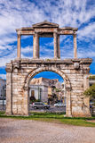 Arch of Hadrian against Parthenon temple on the Acropolis in Athens, Greece Stock Photo