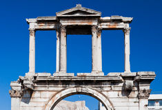 Arch of Hadrian Athens Greece. The Arch of Hadrian in downtown Athens framing a Greek flag, Greece Royalty Free Stock Image
