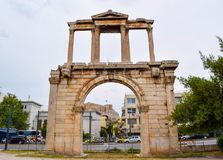 Arch of Hadrian in Athens. Athens, Greece - June 16, 2017: Arch of Hadrian on the background of Athenian Acropolis Stock Photos