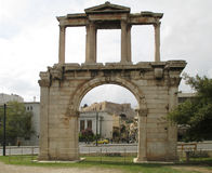 The Arch of Hadrian or Hadrian`s Gate with the Acropolis of Athens in the Background, Athens. Greece Royalty Free Stock Photography