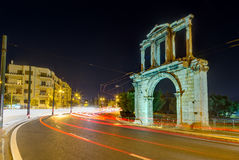 Arch of Hadrian at night, Athens, Greece. The Arch of Hadrian is a monumental gateway resembling a Roman triumphal arch. It spanned an ancient road from the Royalty Free Stock Photo