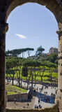 Through the Arch of History. The historical windows of Colosseum Royalty Free Stock Photo