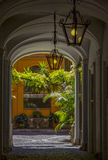 Arch house with green bushes. And branches in the sunlight Stock Images