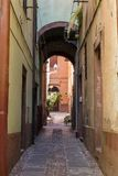 Arch and houses on the narrow streets Stock Photography