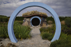 Arch with hut. Round arch with a hut in the background Stock Photo