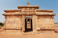 Arch inside the 7th century brick temple, medieval era Hindu temple in Aihole, India. Ancient Indian artwork. Stock Photo