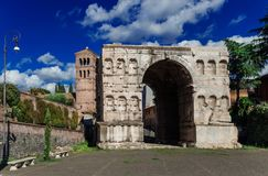 Arch of Janus in Rome. The so called Arch of Janus ruins with old church bell tower in the center of Rome Stock Image