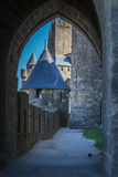 An arch in La Cite. Part of fortification of medieval city La Cite in Carcassonne with an arch royalty free stock photo