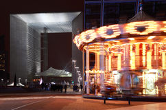 Arch of La Defense and whirling carousel in Paris Stock Image