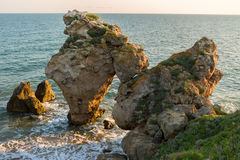 Arch of large stones in the Sea Azov on Generals beach. Karalar regional landscape park Crimea. Stock Image