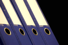 Arch lever files. Side view on some blue arch lever files in a row stock photo